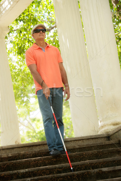Stock photo: Blind Man Walking And Descending Stairs In City Park