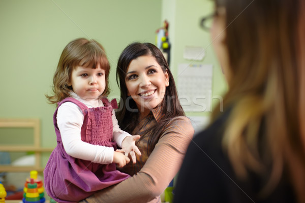 Stock photo: Educator and mother with little girl at school