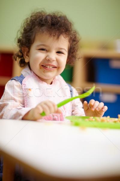 little girl eating lunch in kindergarten Stock photo © diego_cervo