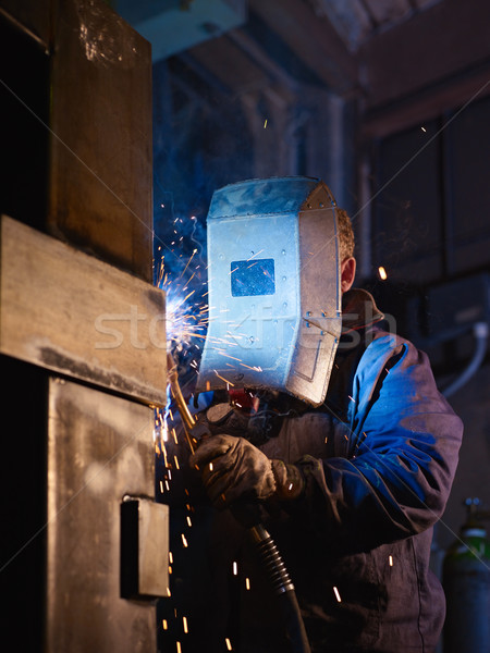 Homme travaux lourd industrie manuel Photo stock © diego_cervo