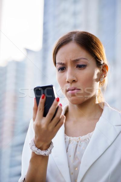 портрет печально деловой женщины набрав sms телефон Сток-фото © diego_cervo