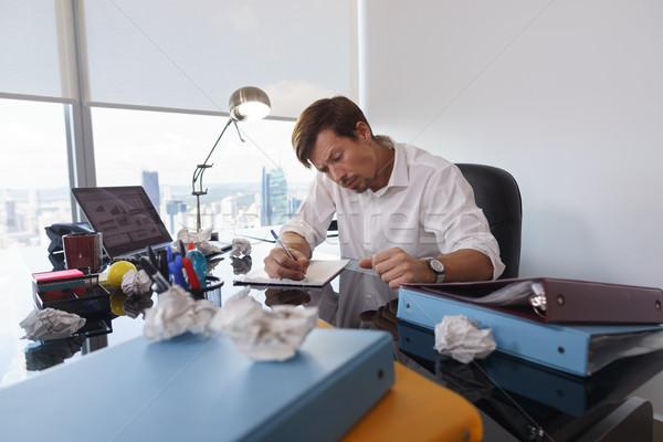 Triste uomo d'affari scrivere carta lettera Foto d'archivio © diego_cervo