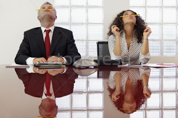 Frustrated colleagues playing at conference call Stock photo © diego_cervo