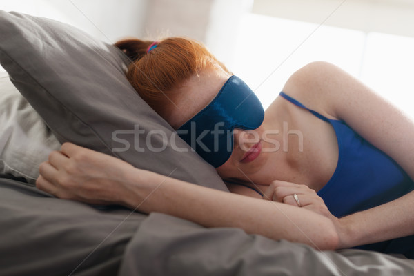 Woman In Bed Sleeping With Sleep Mask On Eyes Stock photo © diego_cervo