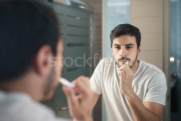 Hispanic Man Brushing Teeth In Bathroom At Morning Stock photo © diego_cervo