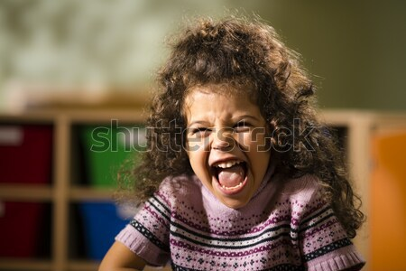 Stock photo: Happy child smiling for joy at camera in kindergarten