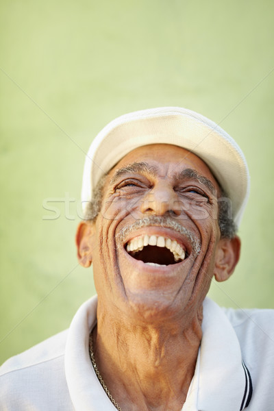 aged latino man smiling for joy Stock photo © diego_cervo