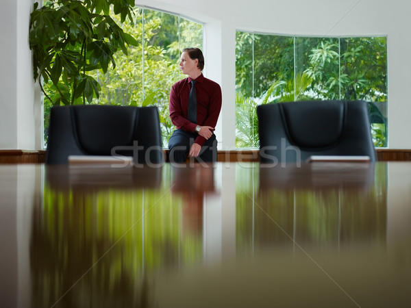 businessman contemplating out of window in meeting room Stock photo © diego_cervo