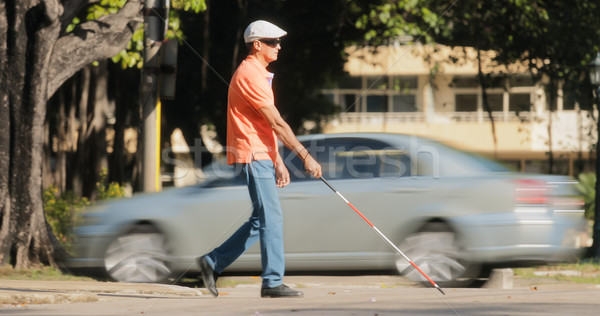 Blind Man Crossing The Road With Cars And Traffic Stock photo © diego_cervo