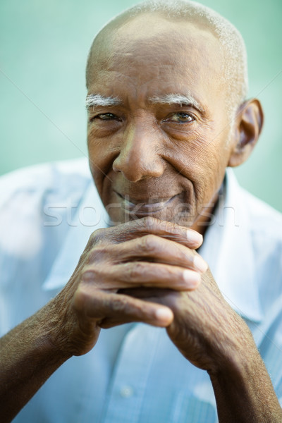 Closeup of happy old black man smiling at camera Stock photo © diego_cervo