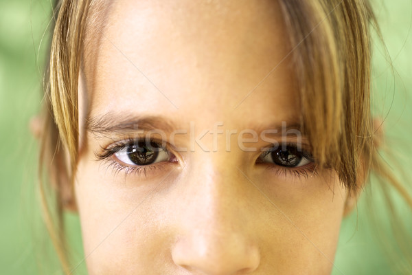 Portrait of serious young girl staring at camera Stock photo © diego_cervo