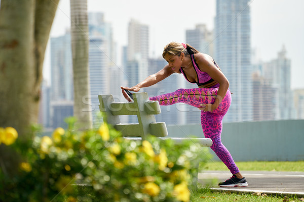 Woman Doing Stretching Before Sports Training At Morning Stock photo © diego_cervo