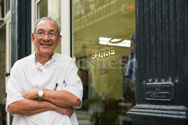 portrait of old barber smiling in hair salon Stock photo © diego_cervo