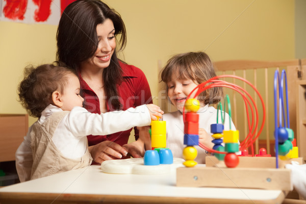two little girls and female teacher in kindergarten Stock photo © diego_cervo