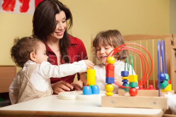 Dois meninas feminino professor jardim de infância criança Foto stock © diego_cervo