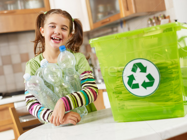 girl recycling plastic bottles Stock photo © diego_cervo