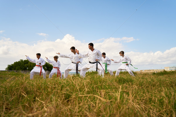 Karate School With Trainers And Boys Warming Up Stock photo © diego_cervo