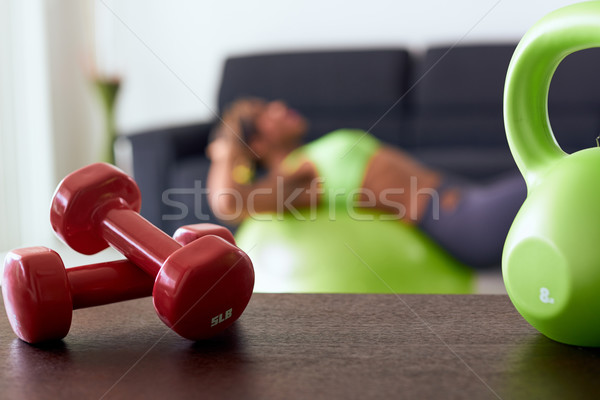 Home Fitness Red Weights On Table And Woman Training Abs Stock photo © diego_cervo