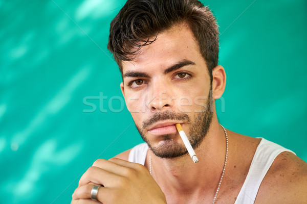 Portrait Of Young Hispanic Man Smoking Cigarette Stock photo © diego_cervo