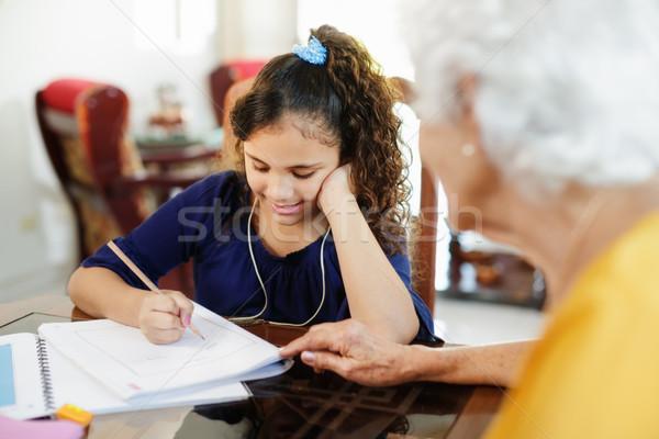 помогают девочку школы домашнее задание счастливым Сток-фото © diego_cervo
