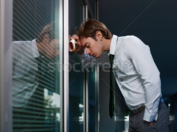 Stock photo: sad businessman banging head against wall