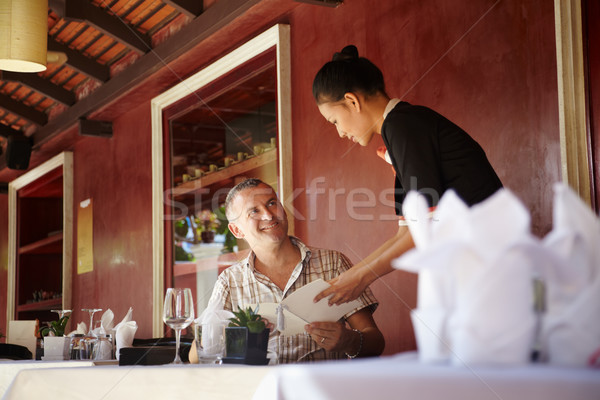 asian waitress talking with client in restaurant Stock photo © diego_cervo
