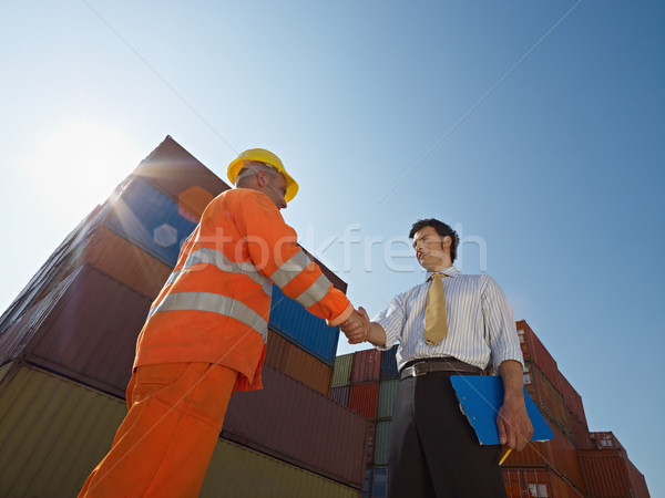businessman and manual worker with cargo containers Stock photo © diego_cervo