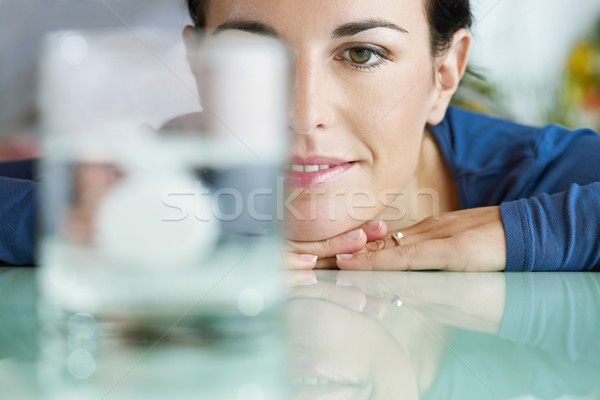 woman looking at aspirin in glass of water Stock photo © diego_cervo