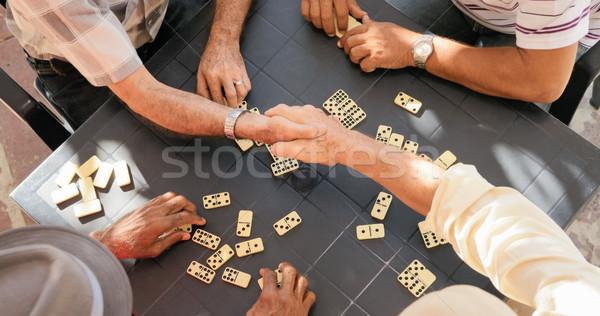 Idős barátok kézfogás nyerő játék dominó Stock fotó © diego_cervo