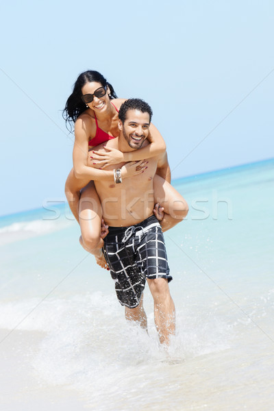 piggyback ride with happy man and woman Stock photo © diego_cervo