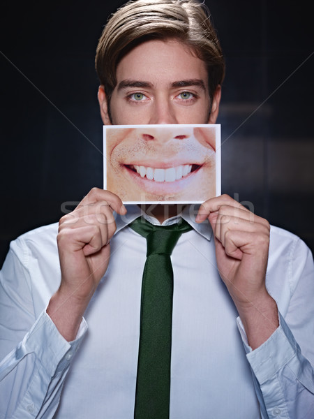 businessman with big mouth smiling at camera Stock photo © diego_cervo