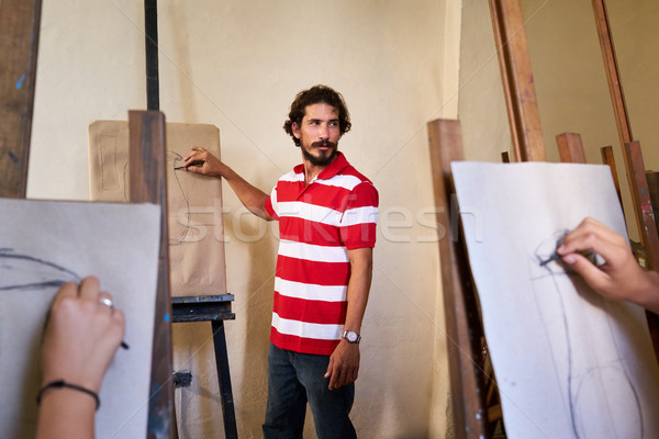 Man At Work As Teacher In Art School With Students Stock photo © diego_cervo