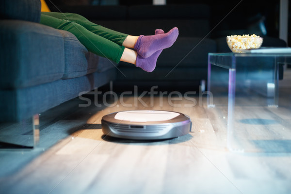 Robot Cleaning Floor While Child Watches TV Movie Stock photo © diego_cervo
