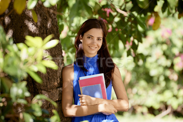 Student portrait at school, happy young woman with university bo Stock photo © diego_cervo