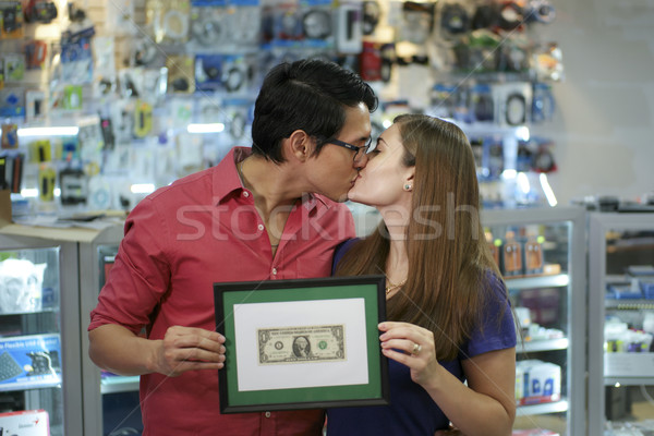 Happy Shop Owners kissing And Showing First Dollar Stock photo © diego_cervo