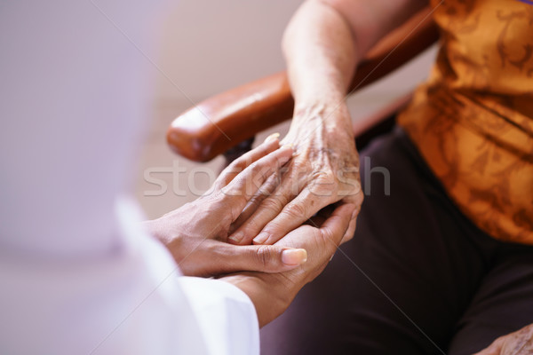 Doctor Vising Senior Woman In Old People Home Stock photo © diego_cervo