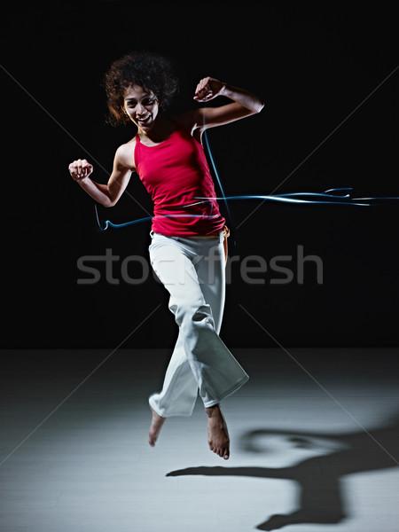 Foto d'archivio: Ispanico · donna · dancing · jumping · luci