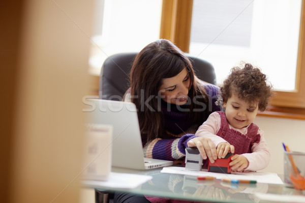 Multitasking mother with her daughter Stock photo © diego_cervo