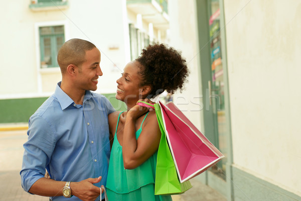 African American Couple Carrying Shopping Bags In Panama City Stock photo © diego_cervo