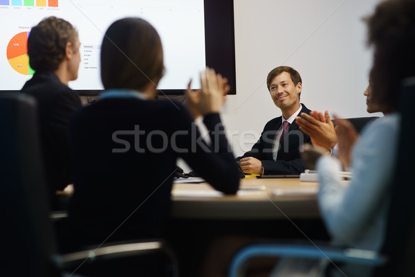 Stock photo: Business People Applauding Manager Doing Presentation In Meeting