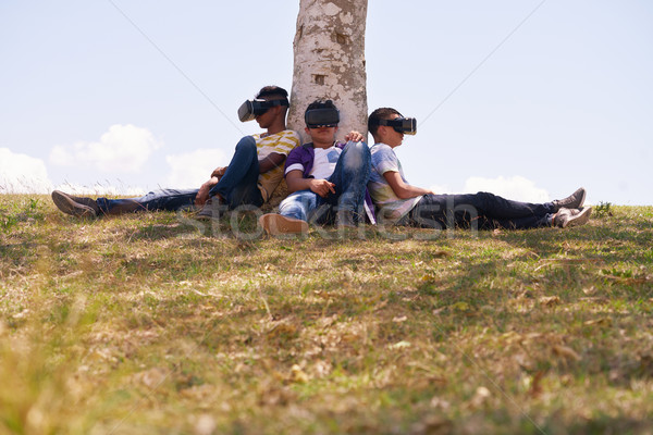 Black And White Teenagers Playing Virtual Reality In Park Stock photo © diego_cervo