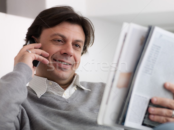 Feliz homem compra telefone retrato Foto stock © diego_cervo