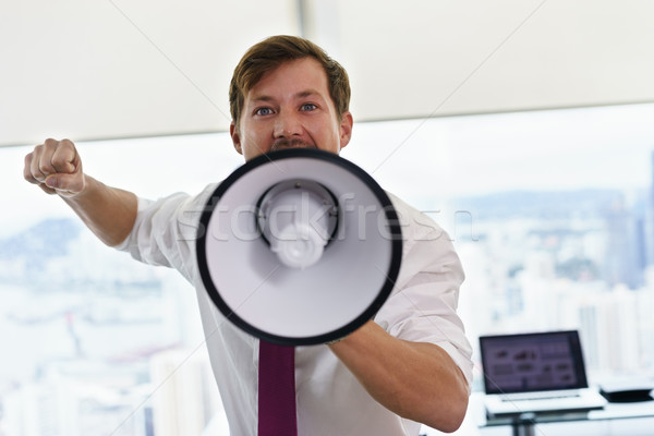 White Collar Worker With Megaphone Fighting For Labor Rights Stock photo © diego_cervo