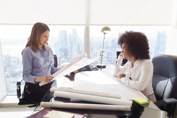 Stock photo: Multiethnic Team Architect Women With Plans And Project
