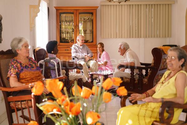 Nővér idős férfi tolószék elfekvő idős emberek fiatal Stock fotó © diego_cervo
