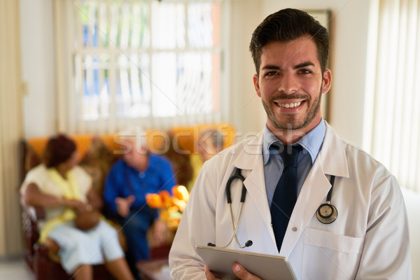 Portrait Of Happy Young Doctor Working In Medical Clinic Stock photo © diego_cervo