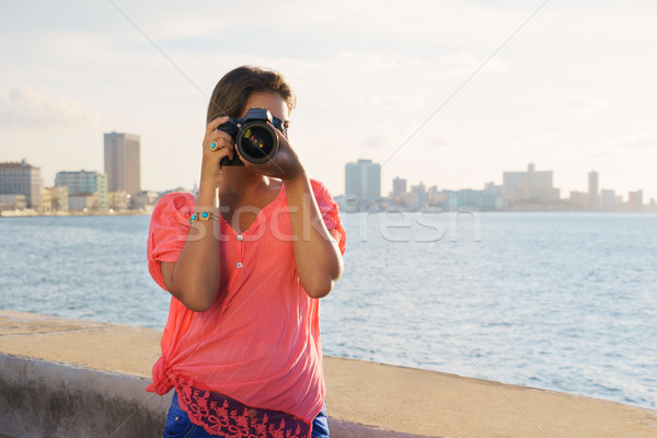 Woman photographer camera tourist picture photo Stock photo © diego_cervo