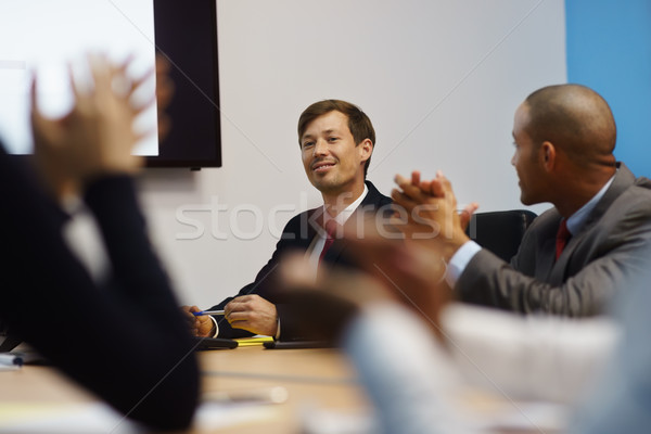 Business Man Doing Presentation And People Applauding In Meeting Stock photo © diego_cervo