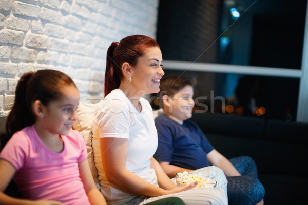 Single Mother And Children Watching TV At Night Stock photo © diego_cervo