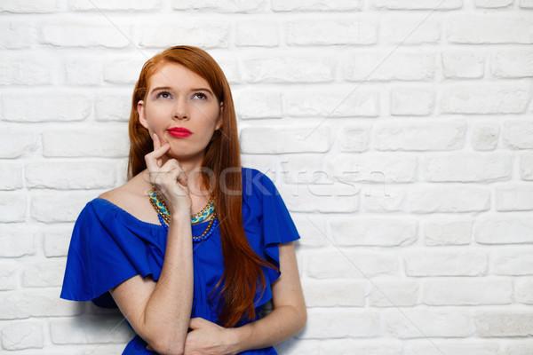 мимике молодые женщину кирпичная стена портрет Сток-фото © diego_cervo